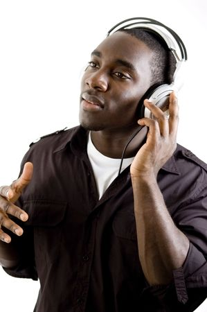 This is an image of a student listenning to music using headphones.