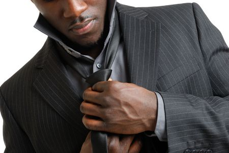 This is an image of business man dressing up and fixing his tie
