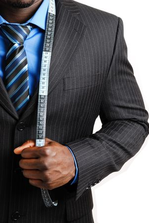 This is an image of business man wearing a tape measure across his suit. photo