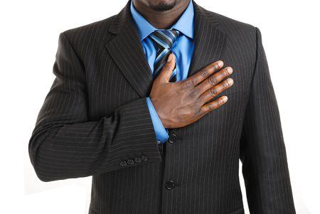 versprechen: Dies ist ein Bild des Unternehmens Mann mit der Hand über seine Brust. Lizenzfreie Bilder