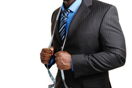 cinta de medir: Esta es una imagen de hombre de negocios el uso de una cinta de medir a trav�s de su ejemplo.