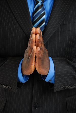 man praying: This is an image of a business man with his hands together showing a prayer gesture. Stock Photo