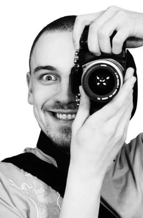 young man with a photographic camera staring from behind the camera Stock Photo