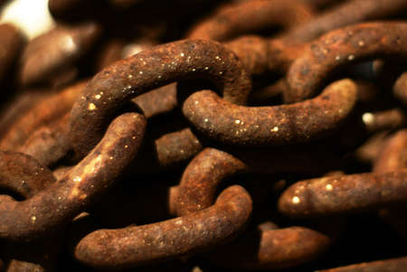 an abstract close-up photo of rusty obsolete chains