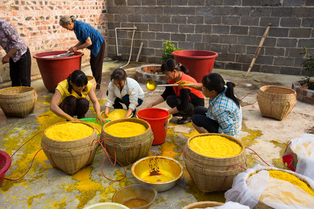 Itaka villagers like colored sticky rice cooking