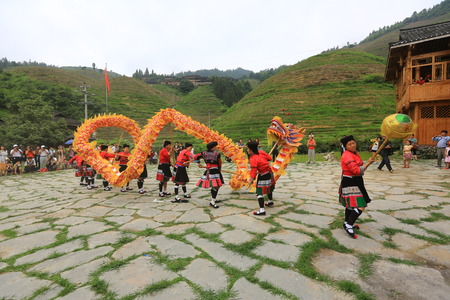 villagers: Dragon dance in a village performed by the villagers