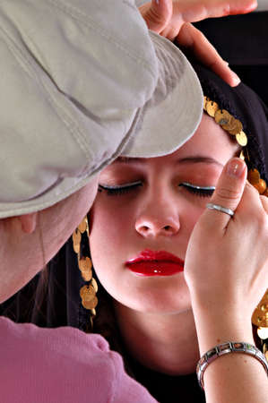 behind the scenes: Amanda assists Kal with her make up in this behind the scenes of a photo shoot shot. Stock Photo
