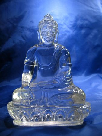rites: Photo of artifact of buddha expertly carved by tibetian master into clear quartz crystal