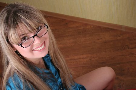 tunic: smiling girl in glasses in blue tunic Stock Photo