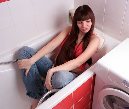 pregnant jeans: beautiful pregnant woman in the bath. looking down Stock Photo