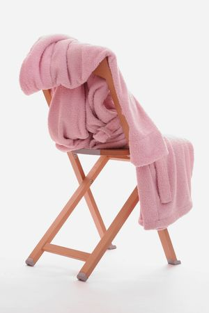 a pink dressing-gown is on the chair. isolated Stock Photo - 917228