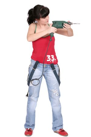 funny woman standing with a drill. white background Stock Photo