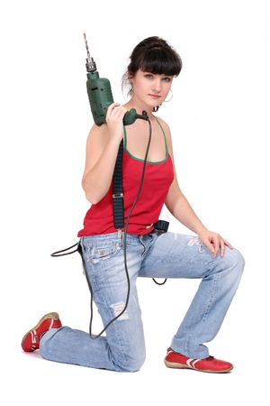 woman and a drill on white background
