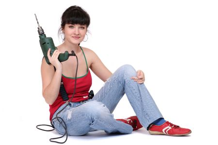 smiling woman sitting with a drill. white background