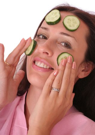 smiling woman with a cucumber mask  photo
