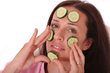 young woman with a cucumber mask photo