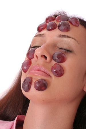 young woman with a grapes mask photo
