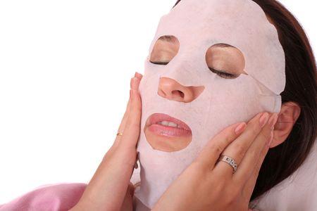 femme masqu�e: jeune femme avec un masque de cosm�tiques  Banque d'images