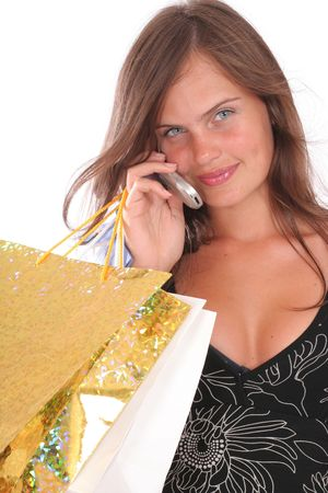 a smiling woman with a shopping bags and a mobile  photo