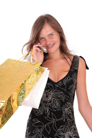 a smiling woman with a shopping bags and a mobile Stock Photo - 2019777