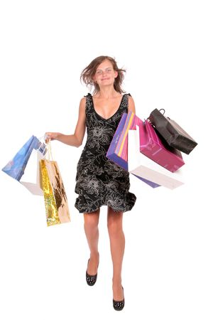 a happy  woman jumping with a shopping bags  Stock Photo