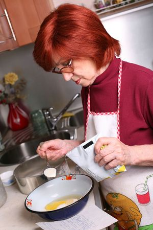 Woman adds milk to the bowl with sugar and broken egg Stock Photo - 4913980