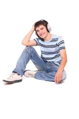 Man is listening to the music over white background Stock Photo - 5136519