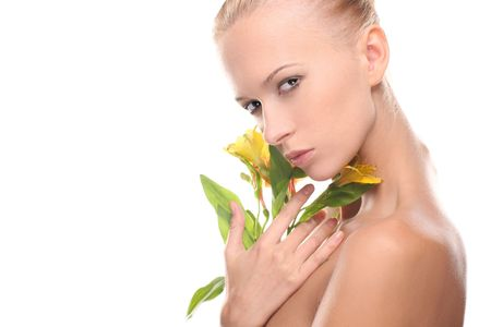 Woman with a flower over whit background Stock Photo