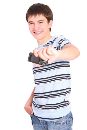 Smiling  guy with a mobile phone  over white background photo