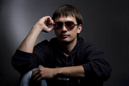 dark portrait of a young man in sunglasses Stock Photo - 5204399