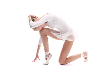 Young dancer in white clothes stands over white background photo