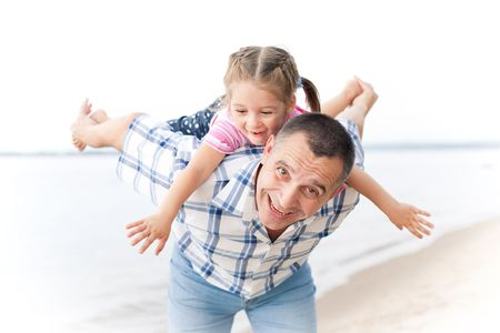 Happy grandfather playing with a smiling granddaughter