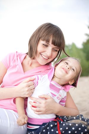 parentage: Portrait of happy young mother and daughter.