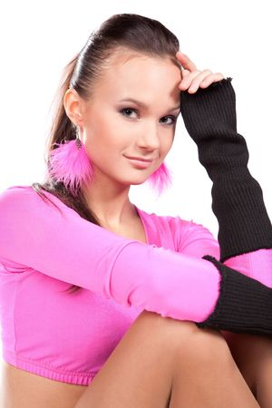 Portrait of an attractive young dancer in bright clothes over white background photo