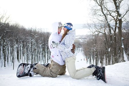 Happy couple of snowboarders