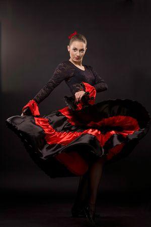 Attractive spanish dancer over black background