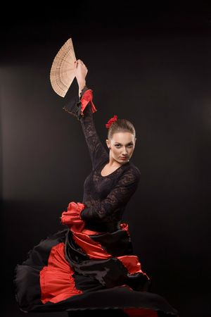 Attractive spanish dancer over black background Stock Photo - 6599375