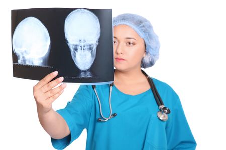 Doctor is looking at X-ray over white background Stock Photo - 7047505