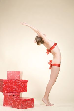 Sexy woman is standing near the present boxes Stock Photo
