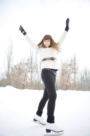 Happy young woman on the skating-ring