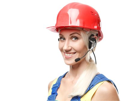 Smiling woman builder with a headset over white background photo