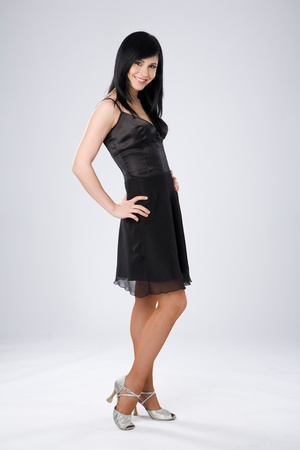 Attractive woman is standing in black dress