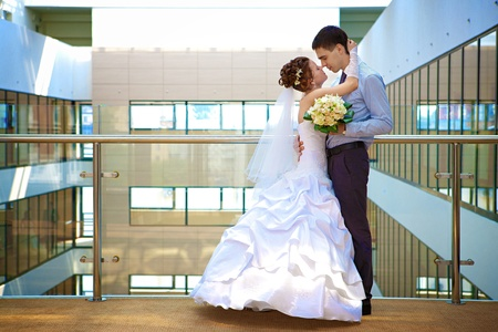 Happy bride and groom is standing in the hotel Stock Photo - 9375304