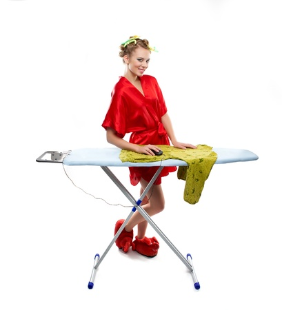 Woman ironing clothes with a computer mouse over white background photo