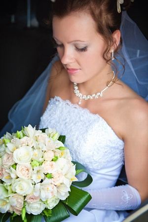 Close-up of a pretty bride with a bouquet of flowers Stock Photo - 9687999