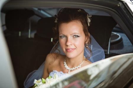 Portrait of a pretty bride in a car Stock Photo - 9687947