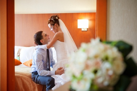 Newlywed couple romancing in the bedroom Stock Photo - 9687991