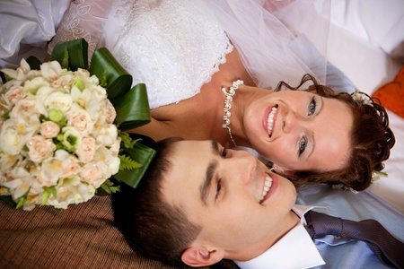 Newlywed couple lying together on the bed Stock Photo