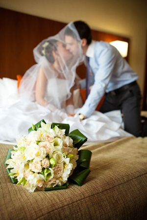 Newlywed couple kissing each other in the bedroom Stock Photo - 9687994