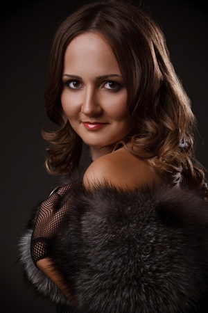 Portrait of a beautiful fashion model smiling wearing dress of fox fur Stock Photo - 12782893